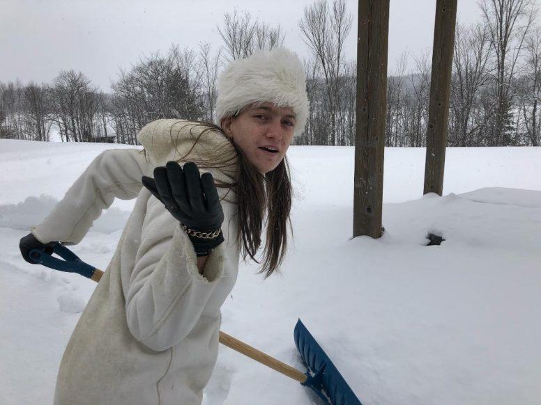 via_woman_shovelling_snow