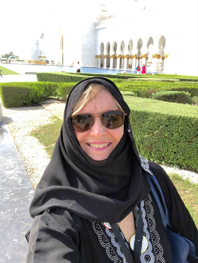Cindy-watson-with-headcovering-traditional-garb-abu-dhabi
